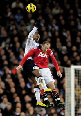 LONDON, ENGLAND - JANUARY 16:  William Gallas of Spurs and Wayne Rooney of Manchester United compete for a header during the Barclays Premier League match between Tottenham Hotspur and Manchester United at White Hart Lane on January 16, 2011 in London, En