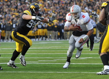 IOWA CITY, IA - NOVEMBER 20:  Defeisive lineman Karl Klug #95 of the University of Iowa Hawkeyes close in for the tackle on quarterback Terrelle Pryor #2 of the Ohio State Buckeyes as he drive the ball towards the goal line during the first half of play a