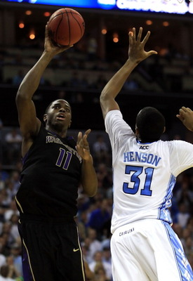 CHARLOTTE, NC - MARCH 20:  Matthew Bryan-Amaning #11 of the Washington Huskies goes up for a shot against John Henson #31 of the North Carolina Tar Heels in the second half during the third round of the 2011 NCAA men's basketball tournament at Time Warner