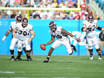 JACKSONVILLE, FL - JANUARY 01:  Quarterback Chris Relf# 36 of the Mississippi State Bulldogs rushes against the Michigan Wolverines during the Gator Bowl at EverBank Field on January 1, 2011 in Jacksonville, Florida  (Photo by Rick Dole/Getty Images)
