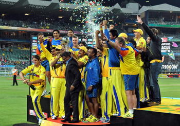 JOHANNESBURG, SOUTH AFRICA - SEPTEMBER 26: The Kings celebrate victory with the trophy during the 2010 Airtel Champions League Twenty20 final match between Chennai Super Kings and Chevrolet Warriors from Bidvest Wanderers Stadium on September 26, 2010 in