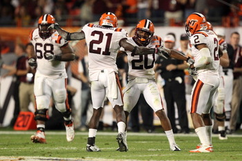 MIAMI, FL - JANUARY 03:  Rashad Carmichael #21 and Jayron Hosley #20 of the Virginai Tech Hokies celebrate after Hosley intercepted a pass in the second quarter against the Stanford Cardinal during the 2011 Discover Orange Bowl at Sun Life Stadium on Janu
