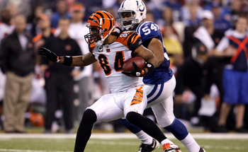 INDIANAPOLIS - DECEMBER 07:  T.J. Houshmanzadeh #84 of the Cincinnati Bengals runs for yards after the catch against Freddy Keiaho #54 of the Indianapolis Colts at Lucas Oil Stadium on December 7, 2008 in Indianapolis, Indiana.  (Photo by Andy Lyons/Getty