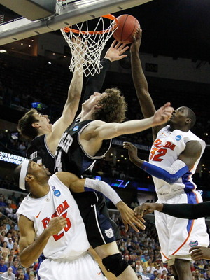 NEW ORLEANS, LA - MARCH 26:  Vernon Macklin #32 of the Florida Gators shoots over Matt Howard #54 and Andrew Smith #44 of the Butler Bulldogs in the second half during the Southeast regional final of the 2011 NCAA men's basketball tournament at New Orlean