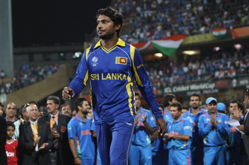 MUMBAI, INDIA - APRIL 02:  Kumar Sangakkara the captain of Sri Lanka walks dejectedly onto the podium to receive his runners up medal after his sides six wicket defeat during the 2011 ICC World Cup Final between India and Sri Lanka at Wankhede Stadium on