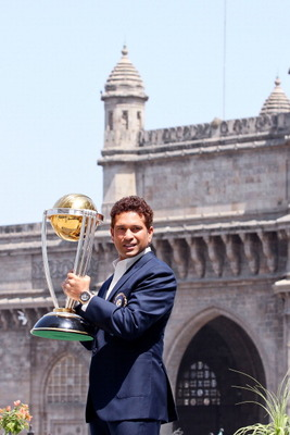 MUMBAI, INDIA - APRIL 03:  Sachin Tendulkar of the Indian cricket team poses with the  ICC Cricket World Cup Trophy, with the Gateway of India in the backdrop, during a photo call  at the Taj Palace Hotel on April 3, 2011 in Mumbai, India.  (Photo by Rita