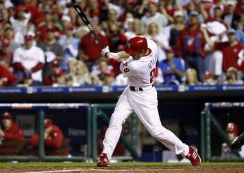 PHILADELPHIA - OCTOBER 08:  Chase Utley #26 of the Philadelphia Phillies hits a 2-RBI single in the fifth inning against the Cincinnati Reds in Game 2 of the NLDS at Citizens Bank Park on October 8, 2010 in Philadelphia, Pennsylvania.  (Photo by Jeff Zele