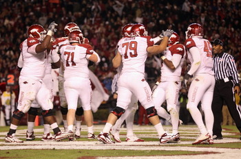 COLUMBIA, SC - NOVEMBER 06:  Knile Davis #7 of the Arkansas Razorbacks is congratulated by teammates after scoring a touchdown against the South Carolina Gamecocks during their game at Williams-Brice Stadium on November 6, 2010 in Columbia, South Carolina