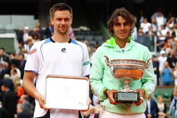 PARIS - JUNE 06:  Rafael Nadal of Spain and Robin Soderling of Sweden pose with their trophies after the men's singles final match between Rafael Nadal of Spain and Robin Soderling of Sweden on day fifteen of the French Open at Roland Garros on June 6, 20