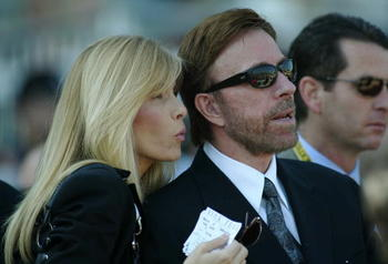ARCADIA, CA - OCTOBER 25:  Actor Chuck Norris and wife Gena O'Kelley attend the 2003 Breeders' Cup World Thoroughbred Championships hosted by the Oak Tree Racing Association October 25, 2003 at Santa Anita Park in Arcadia, California.  (Photo by Jeff Gold