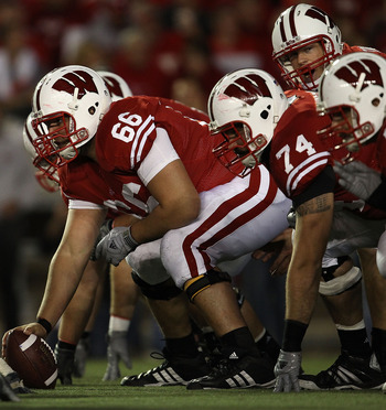 MADISON, WI - OCTOBER 16: Peter Konz #66 of the Wisconsin Badgers prepares to snap the ball to Scott Tolzien #16 against the Ohio State Buckeyes at Camp Randall Stadium on October 16, 2010 in Madison, Wisconsin. Wisconsin defeated Ohio State 31-18.  (Phot