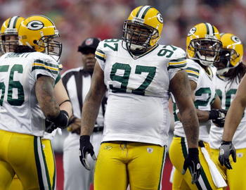 GLENDALE, AZ - JANUARY 03:  Johnny Jolly #97 of the Green Bay Packers looks on from the field against the Arizona Cardinals at University of Phoenix Stadium on January 3, 2010 in Glendale, Arizona.  (Photo by Jamie Squire/Getty Images)