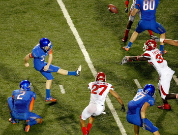 LAS VEGAS, NV - DECEMBER 22:  Justin Taplin-Ross #33 of the Utah Utes blocks a field goal attempt by Kyle Brotzman #35 of the Boise State Broncos during the MAACO Bowl Las Vegas at Sam Boyd Stadium December 22, 2010 in Las Vegas, Nevada. Boise State Won 2