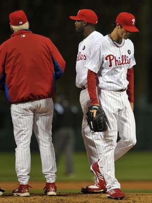 PHILADELPHIA, PA - APRIL 05: Starting pitcher Cole Hamels #35 of the Philadelphia Phillies walks from the mound after being pulled from the game by manager Charlie Manuel in the third inning during the game against the New York Mets at Citizens Bank Park
