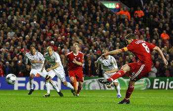 LIVERPOOL, UNITED KINGDOM - MARCH 10:  Steven Gerrard of Liverpool scores his team's second goal from the penalty spot during the UEFA Champions League Round of Sixteen, Second Leg match between Liverpool and Real Madrid at Anfield on March 10, 2009 in Li