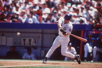 25 May 1996: Catcher Todd Hundley of the New York Mets swings at a pitch during the Mets 7-2 loss to the San Diego Padres at Shea Stadium in New York, New York.