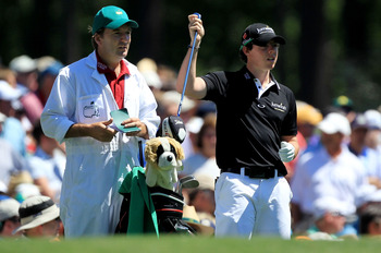 AUGUSTA, GA - APRIL 07:  Rory McIlroy of Northern Ireland pulls a club alongside his caddie J.P. Fitzgerald on the 12th hole during the first round of the 2011 Masters Tournament at Augusta National Golf Club on April 7, 2011 in Augusta, Georgia.  (Photo