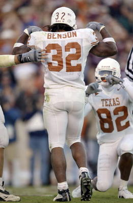CORRECTED: COLLEGE STATION, TX - NOVEMBER 28:  Running back Cedric Benson #32 of the Texas Longhorns flexes his biceps and poses after a touchdown as B.J. Johnson #82 pretends to take his picture against the Texas A&M Aggies in the third quarter November