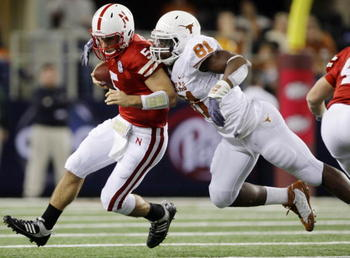 ARLINGTON, TX - DECEMBER 5: Quarterback Zac Lee of the Nebraska Cornhuskers is sacked by Sam Acho #81 of the Texas Longhorns at Cowboys Stadium on December 5, 2009 in Arlington, Texas. (Photo by Jamie Squire/Getty Images)