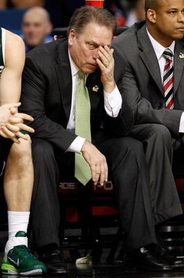 TAMPA, FL - MARCH 17:  Head coach Tom Izzo of the Michigan State Spartans covers his face on the bench against during the second round of the 2011 NCAA men's basketball tournament at St. Pete Times Forum on March 17, 2011 in Tampa, Florida.  (Photo by J.