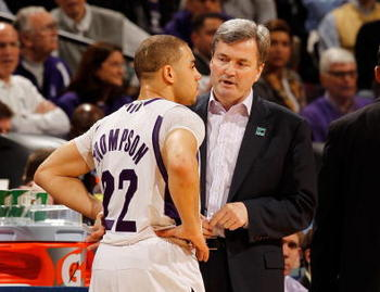 INDIANAPOLIS - MARCH 11:  Head coach Bill Carmody of the Northwestern Wildcats speaks with guard Michael Thompson #22 during the game against the Indiana Hoosiers in the first round of the Big Ten Men's Basketball Tournament at Conseco Fieldhouse on March