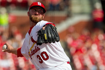 ST. LOUIS, MO - APRIL 6: Reliever Jason Motte #30 of the St. Louis Cardinals pitches against the Pittsburgh Pirates at Busch Stadium on April 6, 2011 in St. Louis, Missouri.  (Photo by Dilip Vishwanat/Getty Images)