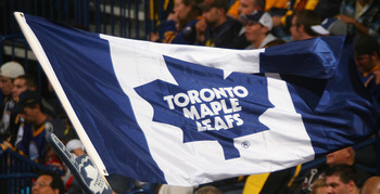 BUFFALO, NY - SEPTEMBER 25: Fans of the Toronto Maple Leafs wave a Maple Leaf flag while playing the Buffalo Sabres  at HSBC Arena on September 25, 2010 in Buffalo, New York.  (Photo by Rick Stewart/Getty Images)