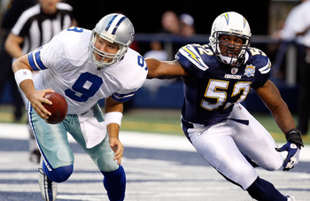ARLINGTON, TX - DECEMBER 13:  Offensive lineman Larry English #52 of the San Diego Chargers chases Tony Romo #9 of the Dallas Cowboys at Cowboys Stadium on December 13, 2009 in Arlington, Texas.  (Photo by Ronald Martinez/Getty Images)