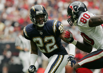 HOUSTON - SEPTEMBER 12:  Sammy Davis #22 of the San Diego Chargers covers Andre Johnson #80 of the Houston Texans on September 12, 2004 at Reliant Stadium in Houston, Texas. The Chargers won 27-20.  (Photo by Ronald Martinez/Getty Images)