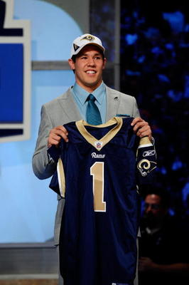 NEW YORK - APRIL 22:  Quarterback Sam Bradford from the Oklahoma Sooners holds up a St. Louis Rams jersey after the Rams selected Bradford numer 1 overall during the first round of the 2010 NFL Draft at Radio City Music Hall on April 22, 2010 in New York
