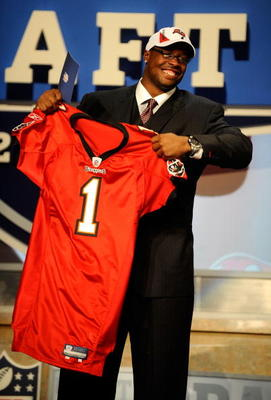 NEW YORK - APRIL 22:  Gerald McCoy (R) of the Oklahoma Sooners celebrates as he holds a Tampa Bay Buccaneers jersey after he was picked third overall by Tampa Bay during the 2010 NFL Draft at Radio City Music Hall on April 22, 2010 in New York City.  (Pho