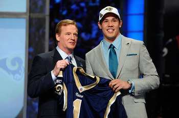 NEW YORK - APRIL 22:  Quarterback Sam Bradford of the Oklahoma Sooners holds up a St. Louis Rams jersey as he stands with NFL Commissioner Roger Goodell after Bradford was picked numer 1 overall by the Rams during the 2010 NFL Draft at Radio City Music Ha