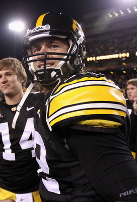 TEMPE, AZ - DECEMBER 28:  Quarterback Ricky Stanzi #12 of the Iowa Hawkeyes walks off the field after defeating the Missouri Tigers in the Insight Bowl at Sun Devil Stadium on December 28, 2010 in Tempe, Arizona. The Hawkeyes defeated the Tigers 27-24.  (