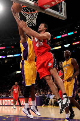 LOS ANGELES, CA - JANUARY 14:  Kris Humphries #43 of the New Jersey Nets shoots over Andrew Bynum #17 of the Los Angeles Lakers at Staples Center on January 14, 2011 in Los Angeles, California. The Lakers won 100-88.  NOTE TO USER: User expressly acknowle