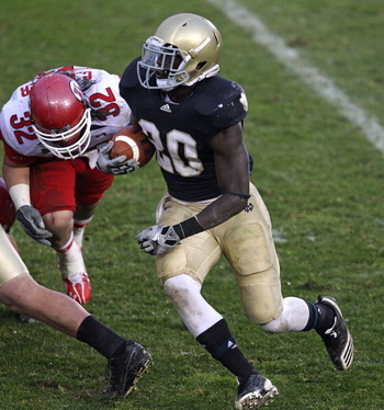 SOUTH BEND, IN - NOVEMBER 13: Cierre Wood #20 of the Notre Dame Fighting Irish runs past Chaz Walker #32 of the Utah Utes at Notre Dame Stadium on November 13, 2010 in South Bend, Indiana. Notre Dame defeated Utah 28-3. (Photo by Jonathan Daniel/Getty Ima