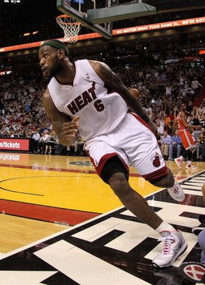 MIAMI, FL - APRIL 06:  LeBron James #6 of the Miami Heat runs up the court during a game against the Milwaukee Bucks at American Airlines Arena on April 6, 2011 in Miami, Florida. NOTE TO USER: User expressly acknowledges and agrees that, by downloading a