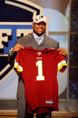 NEW YORK - APRIL 22:  Trent Williams from the Oklahoma Sooners holds a Washington Redskins jersey after Washington selected Williams number 4 overall during the first round of the 2010 NFL Draft at Radio City Music Hall on April 22, 2010 in New York City.