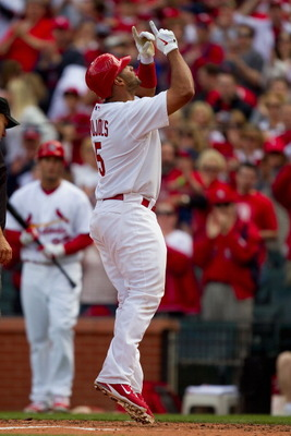 ST. LOUIS, MO - APRIL 2: Albert Pujols #5 of the St. Louis Cardinals celebrates a home run against the San Diego Padres at Busch Stadium on April 2, 2011 in St. Louis, Missouri.  (Photo by Dilip Vishwanat/Getty Images)