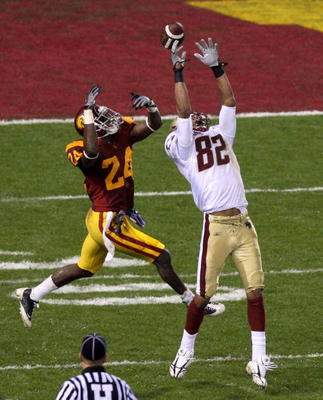 SAN FRANCISCO - DECEMBER 26: Shareece Wright #24 of the USC Trojans breaks up a pass to Justin Jarvis #82 of the Boston College Eagles during the 2009 Emerald Bowl at AT&T Park on December 26, 2009 in San Francisco, California. (Photo by Jed Jacobsohn/Get