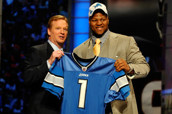 NEW YORK - APRIL 22:  Ndamukong Suh of the Nebraska Cornhuskers stands with NFL Commissioner Roger Goodell as he holds up a Detroit Lions Jersey after Suh was picked #2 overall by the Lions during the 2010 NFL Draft at Radio City Music Hall on April 22, 2