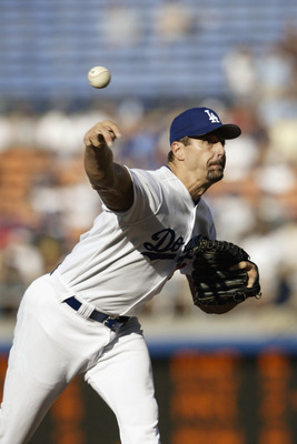 LOS ANGELES - AUGUST 24:  Starting pitcher Kevin Brown #27 of the Los Angeles Dodgers delivers a pitch during the National League game against the New York Mets at Dodgers Stadium on August 24, 2003 in Los Angeles, California. The Mets defeated the Dodger