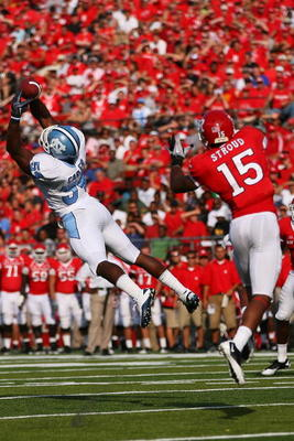 NEW BRUNSWICK, NJ - SEPTEMBER 25: Bruce Carter #54 of the North Carolina Tar Heels intercepts a pass intented for Keith Stroud #15 of the Rutgers Scarlet Knights during the second quarter at Rutgers Stadium on September 25, 2010 in New Brunswick, New Jers