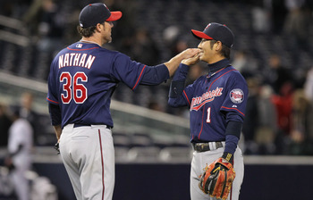 NEW YORK, NY - APRIL 05: Joe Nathan #36 of the Minnesota Twins celebrates the win with Tsuyoshi Nishioka #1 against the New York Yankees at Yankee Stadium on April 5, 2011 in the Bronx borough of New York City.  (Photo by Nick Laham/Getty Images)