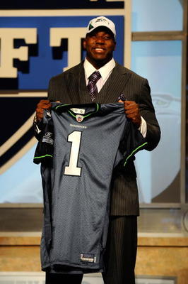NEW YORK - APRIL 22:  Russell Okung from the Oklahoma State Cowboys holds a Seattle Seahawks jersey after he was selected #6 overall by the Seahawks in the first round during the 2010 NFL Draft at Radio City Music Hall on April 22, 2010 in New York City.