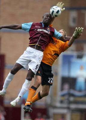 LONDON, ENGLAND - AUGUST 21:  Carlton Cole of West Ham United and Jussi Jaaskelainen of Bolton Wanderers jump for the ball during the Barclays Premier League match between West Ham United and Bolton Wanderers at the Boleyn Ground on August 21, 2010 in Lon