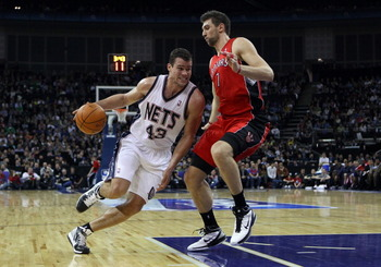 LONDON, ENGLAND - MARCH 04:  Kris Humphries of the Nets goes around Andrea Bargnani of the Raptors during the NBA match between New Jersey Nets and the Toronto Raptors at the O2 Arena on March 4, 2011 in London, England. NOTE TO USER: User expressly ackno