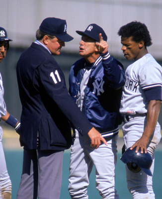 BRONX, NEW YORK - APRIL 7:  Manager Billy Martin of the New York Yankees argues with an umpire as outfielder Rickey Henderson #24 watches during the game on April 7, 1988 at Yankee Stadium in Bronx, New York. (Photo by Jonathan Daniel/Getty Images)