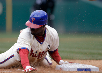 PHILADELPHIA, PA - APRIL 01: Jimmy Rollins #11 of the Philadelphia Phillies slides safely into third base against the Houston Astros during opening day at Citizens Bank Park on April 1, 2011 in Philadelphia, Pennsylvania.  (Photo by Rob Carr/Getty Images)