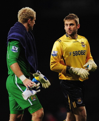 LONDON, UNITED KINGDOM - DECEMBER 11:  Joe Hart (L) the Manchester City goalkeeper talks with Robert Green (R) the West Ham United goalkeeper following the Barclays Premier League match between West Ham United and Manchester City at Upton Park on December