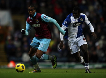 BLACKBURN, ENGLAND - DECEMBER 18:  Mame Biram Diouf of Blackburn chases Frederic Piquionne of West Ham during the Barclays Premier League match between Blackburn Rovers and West Ham United at Ewood park on December 18, 2010 in Blackburn, England.  (Photo